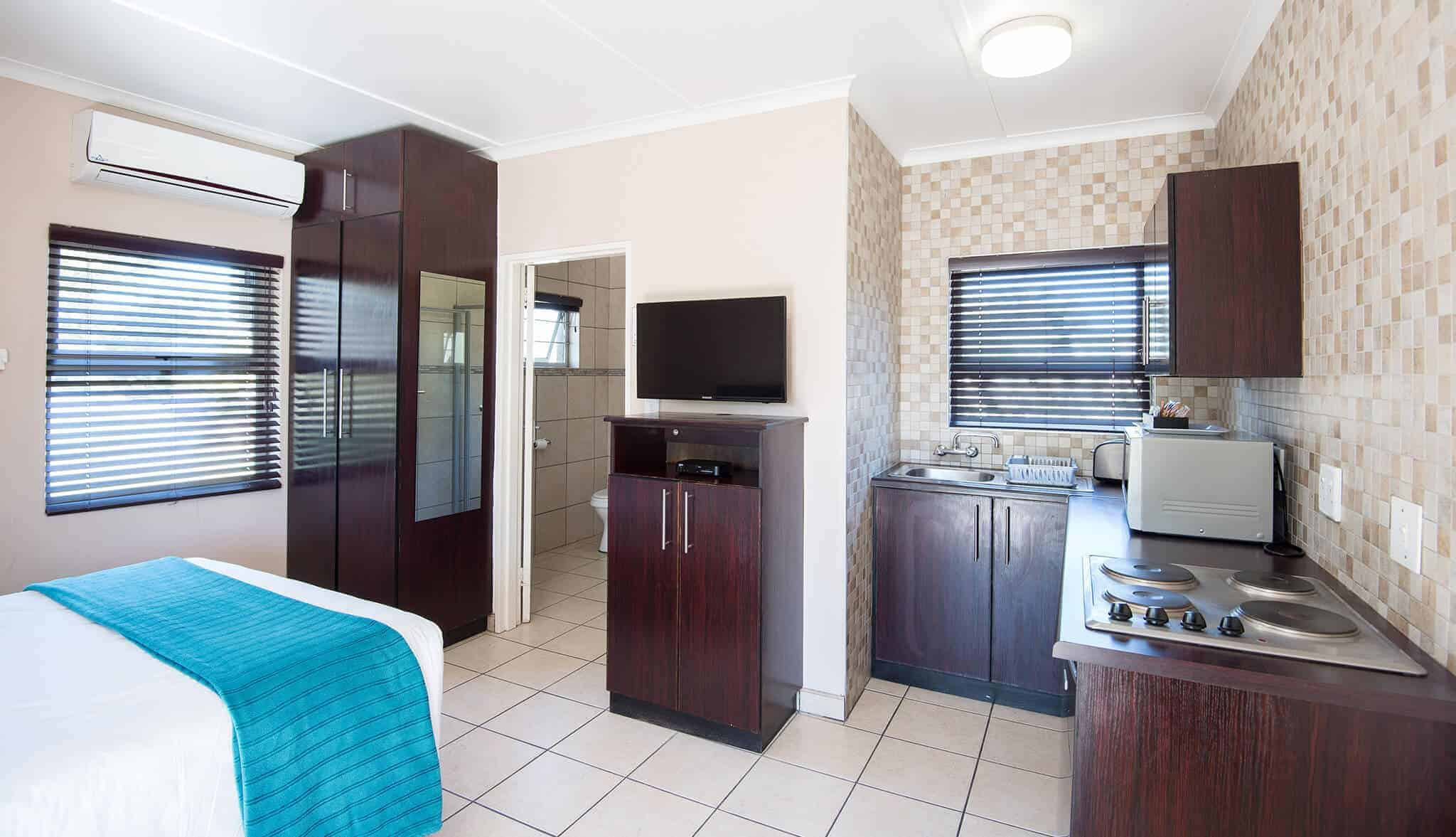 Small Chalet | Double | Self-Catering Accommodation In Windhoek |  Arebbusch Travel Lodge